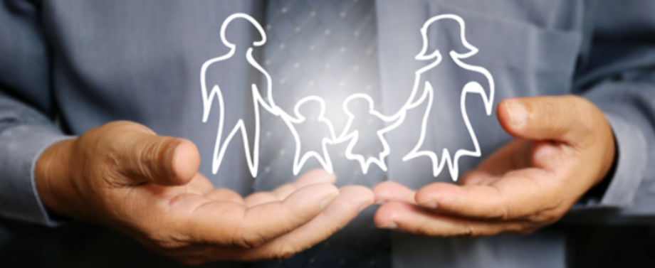 Close up of man wearing a tie holding a hand drawn illustration of a family. Life Insurance.
