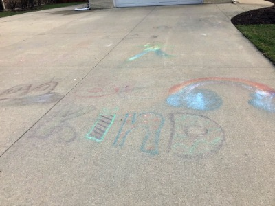 Child's chalk drawing on driveway.