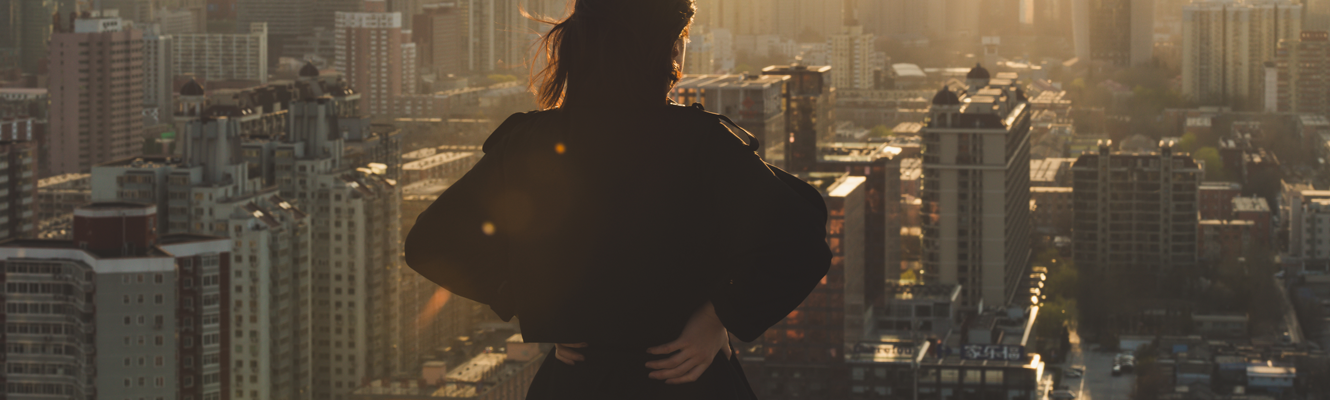 Business woman looking over skyline.