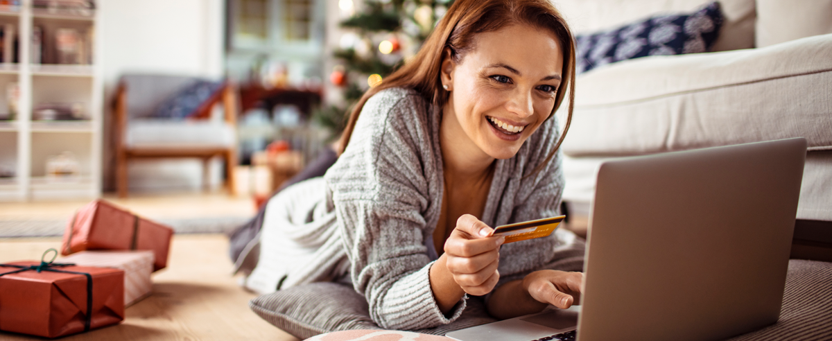 Close up of a young woman buying presents online.