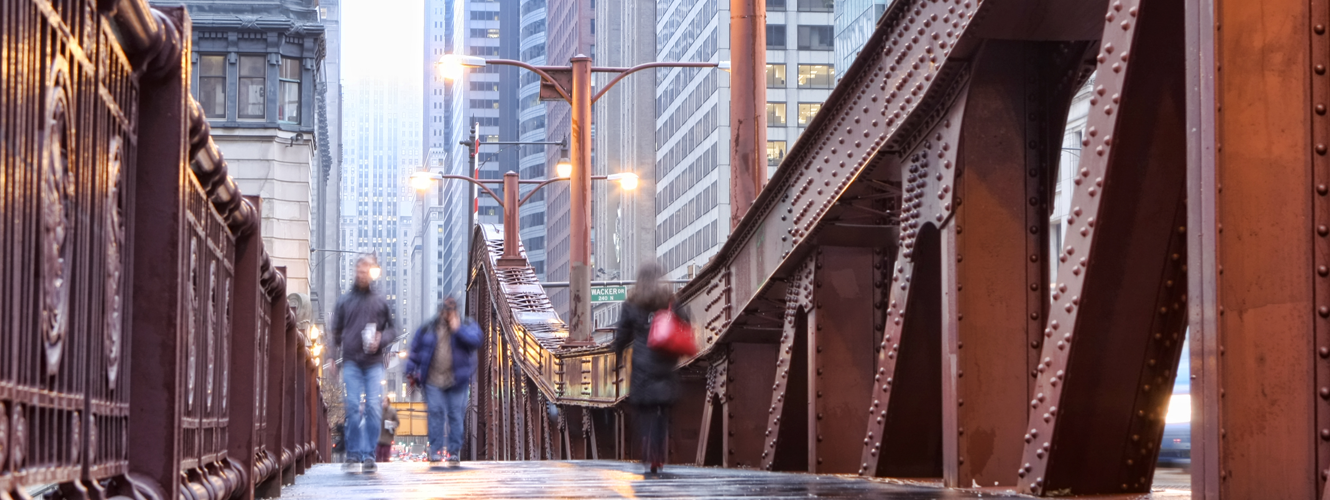 People walking across LasSalle Street Bridge, Chicago.